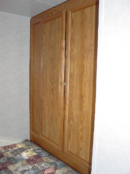 closets in front of bed